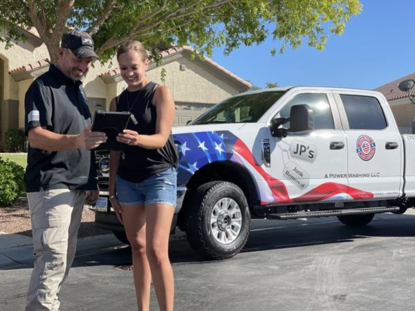 Las Vegas junk removal professional interacting with a client